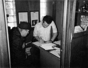 Joe signing paperwork